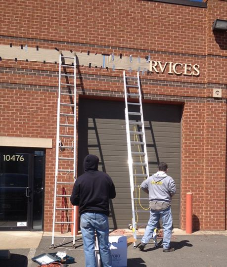 New signage going up at Lambert Metal Services!